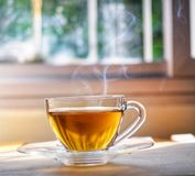 Hot tea on wood table stock image