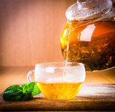 Hot tea. Hot tea on wooden background Royalty Free Stock Photo