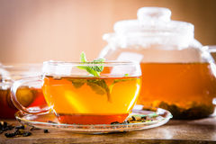Hot tea. On wooden background Royalty Free Stock Photo