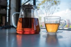 Hot teapot and teacup in a table. royalty free stock photography