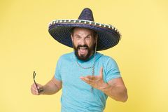 Hot tempered people. Man shouting face in sombrero hat yellow background. Guy with beard looks annoyed or angry in. Sombrero. Traditional rules of behaviour and Royalty Free Stock Photography