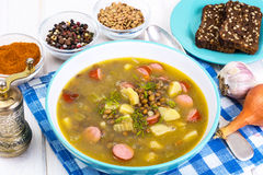 Hot and thick soup with lentils and sausages royalty free stock photos