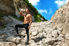 Hot Thirsty Man Drinking Water Drink After Running Outdoors. Sport Royalty Free Stock Photo