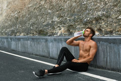 Hot Thirsty Man Drinking Water Drink After Running Outdoors. Sport Stock Photography