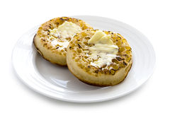 Hot toasted crumpets with butter Stock Photo