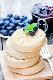 Hot  toasted  crumpets on the wooden table with blueberries and j Stock Images