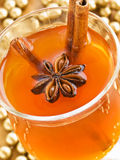 Hot toddy. Glass of hot toddy with cinnamon and anise. Shallow dof Stock Images