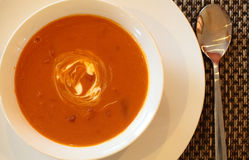 Hot Tomato Soup. With Sour Cream In a Bowl with Spoon Stock Photo