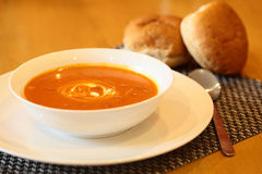 Hot Tomato Soup. With Sour Cream In a Bowl with Spoon Royalty Free Stock Photos