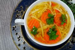 Hot traditional chicken soup in a white dish - energy and warming meal on a cold Christmas day Stock Image