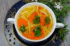 Hot traditional chicken soup in a white dish - energy and warming meal on a cold Christmas day Royalty Free Stock Image
