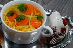 Hot traditional chicken soup in a white dish - energy and warming meal on a cold day Stock Photo