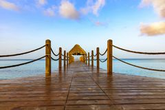 Hot tropical day the Caribbean sea pier with pergola Royalty Free Stock Photos