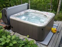 Hot Tub. A hot tub spa in a wooded backyard and garden stock image