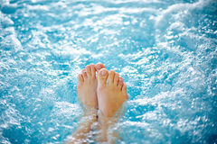 Hot tub. Close-up of female legs in hot tub royalty free stock photography