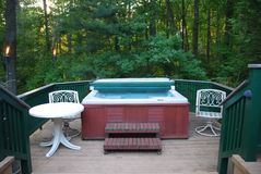 Hot tub on deck. Hot tub with chairs on a deck Royalty Free Stock Photos
