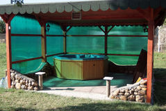 Hot tub in its house. Hot tub in its wooden  garden house Royalty Free Stock Photos