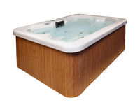 Hot tub. Modern hot tub with wooden frame isolated with clipping path included royalty free stock photo