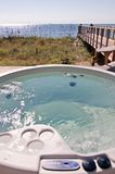 Hot tub on the ocean Stock Photo