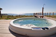 Hot tub on the ocean. Bubbling hot tub with oceanfront view royalty free stock photos