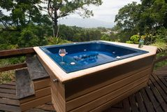 Hot tub in paradise. Hot tub, hottub, tub, water, costa rica, paradise, tropical, relax, peace, peaceful, mountains, view, trees, patio, yard, drink, orange stock photography