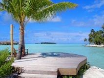 Hot Tub In The Tropics. A hot tub made for two overlooking the crystal clear tropical waters of the South Pacific stock photography