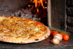 Hot Tuna pizza with oven fire Stock Image