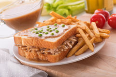 Hot Turkey Sandwich. A delicious hot turkey sandwich with gravy, green peas, and french fries Royalty Free Stock Photography