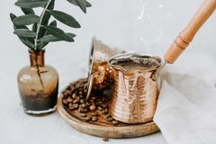Hot Turkish coffee in Cooper with coffee beens. On rural linen background Stock Images