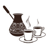 Hot Turkish coffee pots in two cups. Hot black Turkish coffee pots in two cups Royalty Free Stock Image