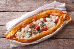 Hot Turkish pide pizza closeup on a table. horizontal top view Stock Photos