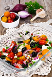 Hot Vegetable Salad with Olives and Feta Stock Photo