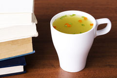 Hot vegetable soup in a cup.