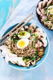Hot vegetarian ramen with miso paste, mushrooms and eggs Stock Photos