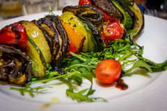 Hot vegetarian shashlik. With courgette, aubergine, onion, red pepper and arugula royalty free stock image
