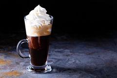 Hot viennese coffee with whipped cream. On dark background Royalty Free Stock Images
