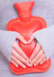 Hot water bag bottle abdomen ill Royalty Free Stock Images