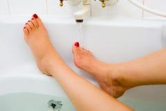 Hot water of bath faucet Stock Photos