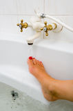 Hot water of bath faucet Royalty Free Stock Photo