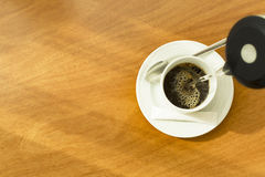 Hot water being poured into a white cup to create a cup of coffee Stock Images