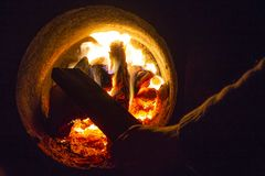 Hot water boiler with open door and fire inside and scoop with coal stock image