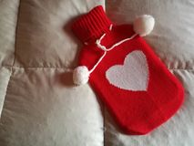 Hot water bottle. With heart Stock Images