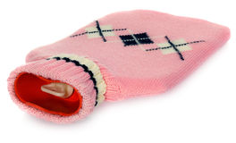 A hot water bottle in pink sweater with white and black patterns Royalty Free Stock Photo