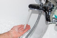 The hot water flows into the tub.  royalty free stock photo