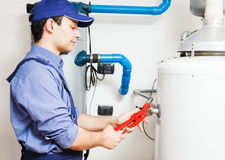 Hot-water heater service Royalty Free Stock Images