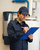 Hot-water heater service Royalty Free Stock Photos