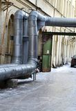 Hot water pipe Stock Images