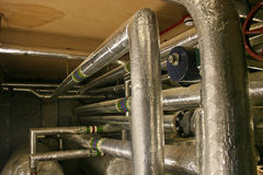 Hot water pipes. And boiler Royalty Free Stock Images