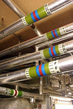 Hot water pipes. In boiler room royalty free stock images