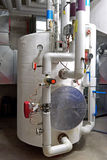 Hot water storage tank in a boiler room Stock Photo